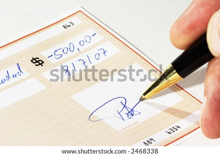 signing a bank check - stock photo