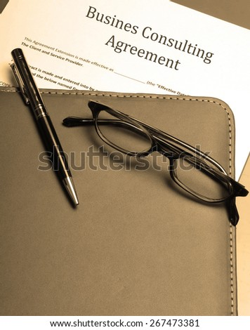 signing a business consulting agreement - stock photo