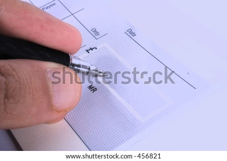 signing a cheque - stock photo