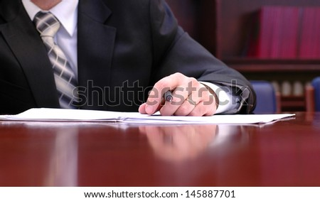 Signing a contract concept, businessman is signing a contract. - stock photo
