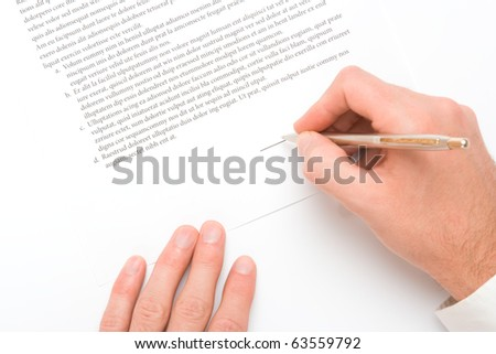Signing a contract - hand with pen closeup - stock photo