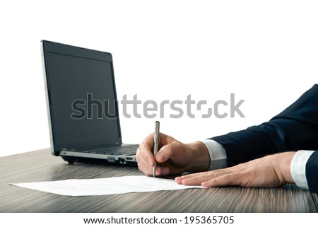 Signing a contract on a table - stock photo