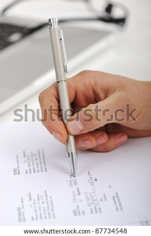Signing a model release - stock photo