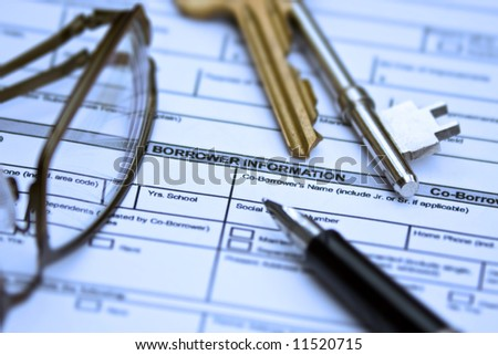 Signing an application form - stock photo