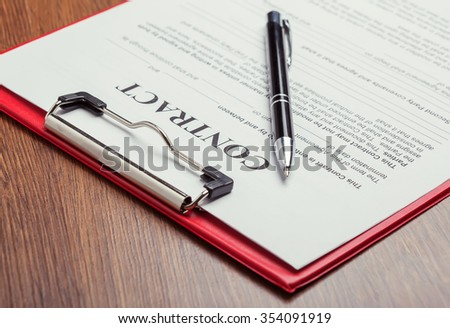 Signing contract - stock photo