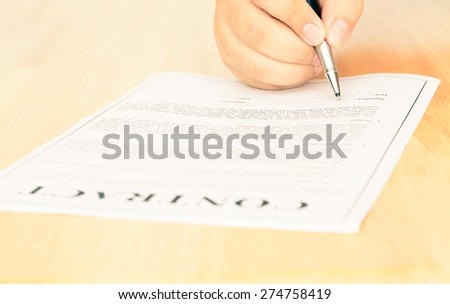 Signing contract form vintage style photograph - stock photo