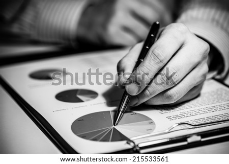 signing finance contract - stock photo