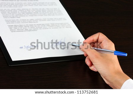 signing of a treaty close-up - stock photo