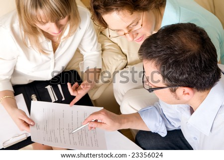 Signing or not signing? - stock photo