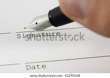 Signing the deal with fountain pen - stock photo