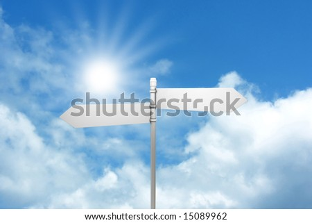 Signpost against blue sky with white clouds