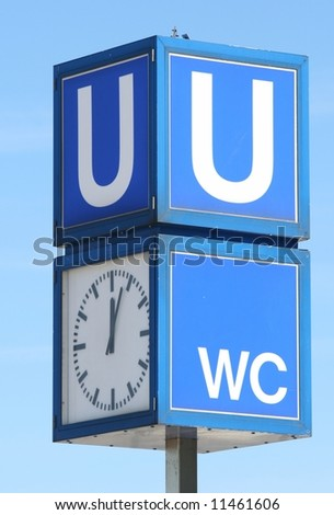 Signpost for Subway (U-Bahn) with Clock - stock photo