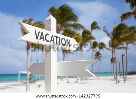 Signpost multiple, vacation - stock photo