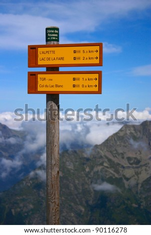 Signpost of hiking trails in the French Alps - stock photo