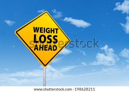 Signpost of weight loss under blue sky - stock photo