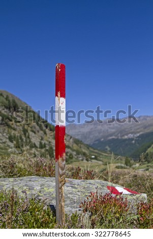 Signpost on a hiking trail in the back of Oetztal valley - stock photo