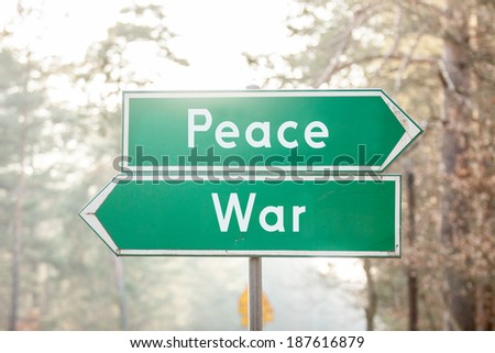 signpost on two sides - Peace or War