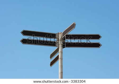 Signpost under blue sky, add your own texts - stock photo