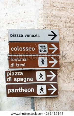 Signpost with directions to famous Rome landmarks - stock photo