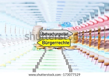 signpost with the german words surveillance state and civil rights over a reflective background with euro money / surveillance state - stock photo