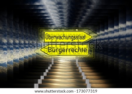 Signpost with the german words surveillance state and civil rights / surveillance state - stock photo