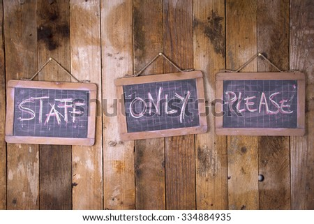 Signposts space reserved to authorized personnel only written with chalk on blackboard - stock photo