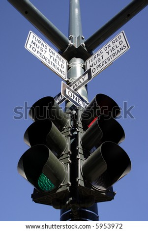 signs and stop light on street corner - stock photo