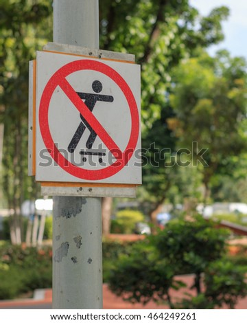 Signs banned skateboarding in the park.