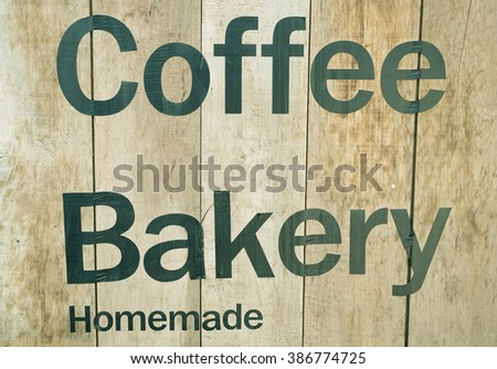 Signs Coffee on wood background.Vintage and retro style. - stock photo