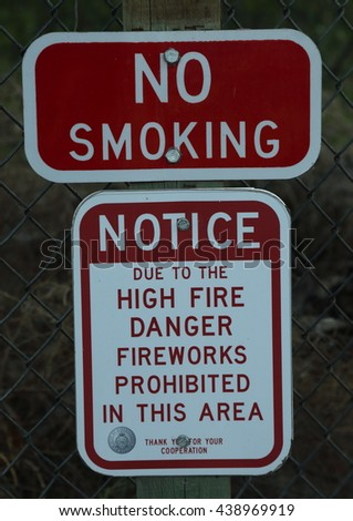 "Signs in New Mexico reading ""No Smoking"" and ""High Fire Danger Fireworks Prohibited"""