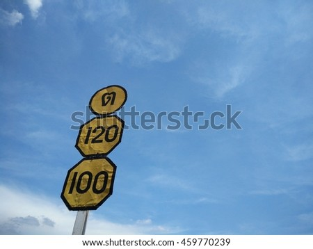 Signs indicating traffic speed Background sky