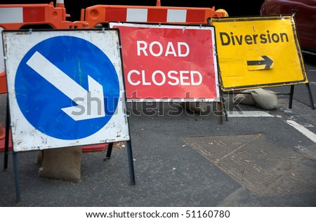 Signs informing about a closed road - stock photo