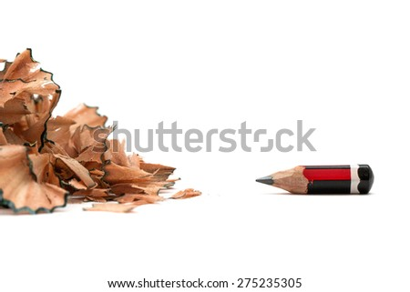 Signs of stress - pencil shavings with small pencil - stock photo