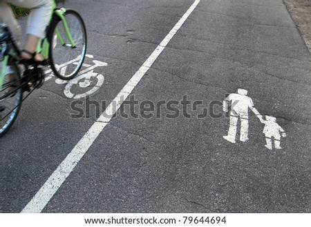 signs on asphalt - stock photo
