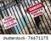 Signs warn of empty pool in the off season - stock photo