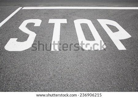 Signs warning to stop at urban road, symbol - stock photo