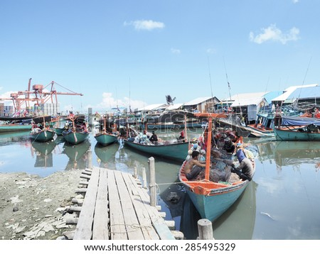 SIHANOUKVILLE SEA PORT - JUNE 4: Goods and products of Cambodia are exported by ships at Sihanoukville sea port on June 4, 2015. Sihanoukville sea port is the biggest port of Cambodia.