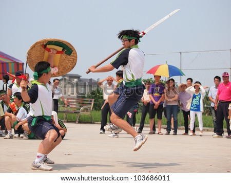 SIKANG, TAIWAN-MAY 6: The performance of martial arts in the Burning King Boat Ceremony in Sikang, Taiwan on May 6, 2012. - stock photo