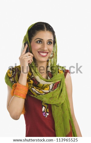 Sikh woman talking on a mobile phone - stock photo