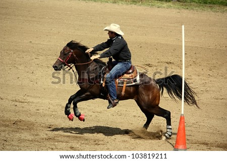 SIKLUV MLYN, CZECH REPUBLIC AUGUST 13: Unidentified rider competes at the Czech Republic Championship Rodeo Show 2011 on August 13, 2011 in Sikluv Mlyn, Czech Republic - stock photo