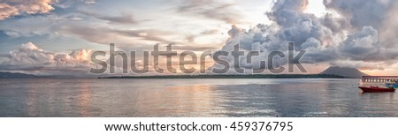 Siladen turquoise tropical paradise island in Indonesia landscape panorama at pink sky sunset - stock photo