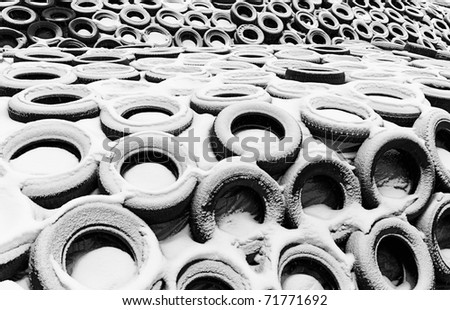 silage covered with tires during winter for protection against snow and frost