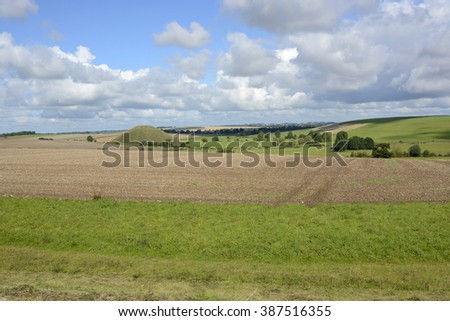 Silbury Hill Ancient artificial mound near Avebury in Wiltshire, England - stock photo