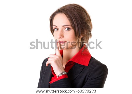 silence gesture, young businesswoman covers her lips with finger, studio shoot isolated on white - stock photo
