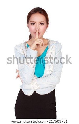 Silence please, attractive businesswoman holds finger on her lips on white background - stock photo