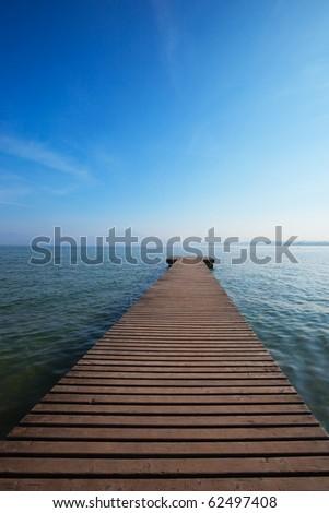 Silent morning at the italian lake. - stock photo