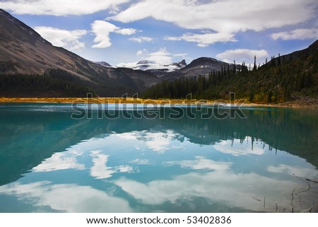 Silent mountain lake with the pure water, surrounded by mountains