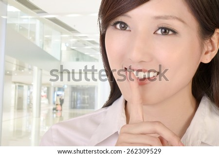 Silent sign with beautiful businesswoman of Asian. - stock photo
