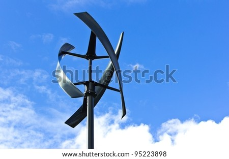 Silent urban styled wind turbine, blue sky. - stock photo