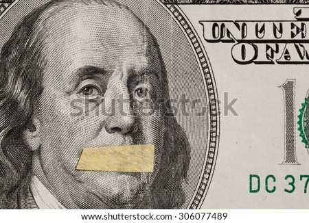 Silente president, portrait of the American leader Benjamin Franklin with mouth closed on the banknote of one hundred dollars USA, as a symbol of the instability of the modern economy - stock photo